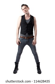 Portrait of young hipster male posing with tight pants and black boots