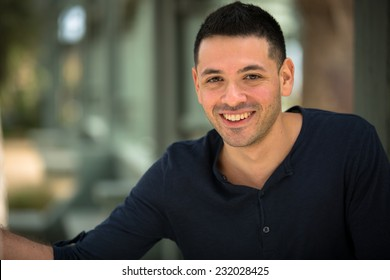 Portrait of a young Hispanic male smiling