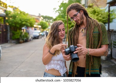 Portrait of young Hispanic tourist couple together in the streets outdoors