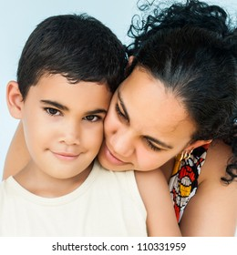 Portrait of an young hispanic woman and her cute son
