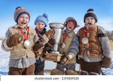 Portrait of young hockey players with a cup after the victory