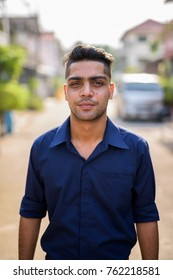 Portrait of young Indian businessman in the streets outdoors