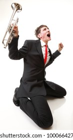 Portrait of a young jazz man joy, glee and his Trumpet white background