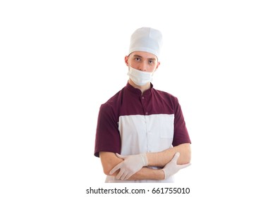 Portrait of a young Laboratory Assistant in the medical CAP and with a mask on his face