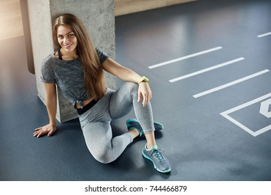 Portrait of young lady body fitness trainer in gym. Beautiful woman caring about her body shape. Sports concept.