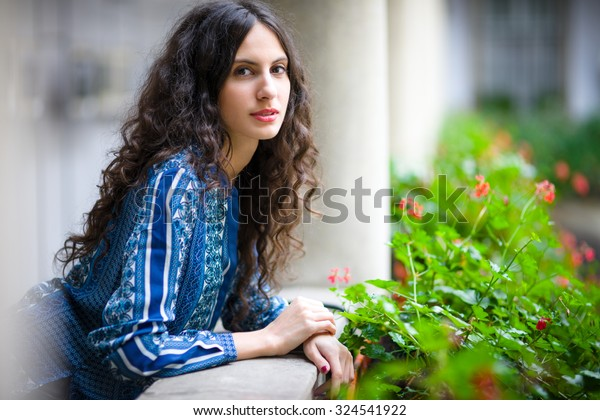 The portrait of young lady in the city