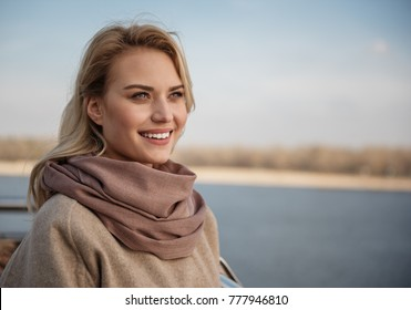 Portrait of young lady expressing harmony and pleasure while looking into distance. Copy space in right side