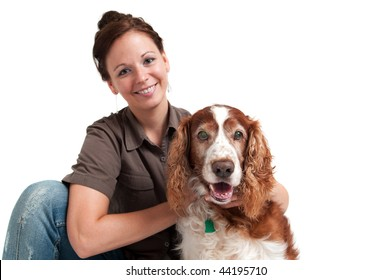 portrait of young lady with her dog, isolated over white, focus on the dog