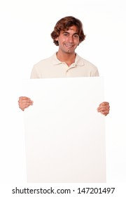 Portrait of a young latin adult, smiling with his left palm out on isolated background. - copyspace