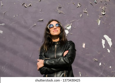 portrait of young latin american woman with big round sunglasses