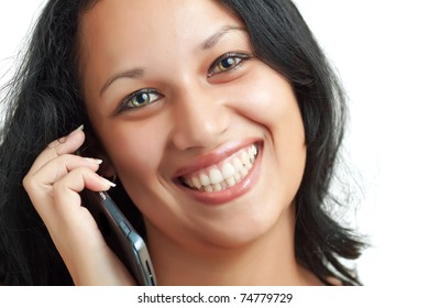 Portrait of a young latin girl with beautiful green eyes talking on a mobile phone isolated on a white background