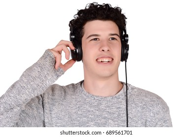Portrait of young latin man listening music with black headphones. Isolated white background.