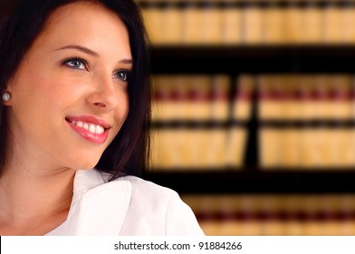 Portrait of a young lawyer standing in front of a bookcase