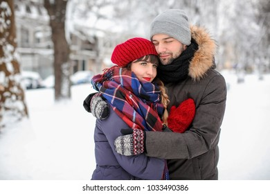 Portrait of young loving couple outdoors on winter day