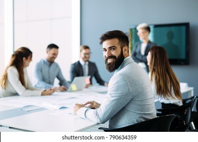 Portrait of young male architect on meeting