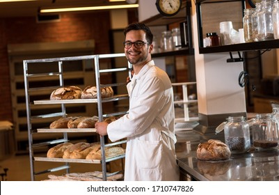 Portrait of young male baker standing at bakery.