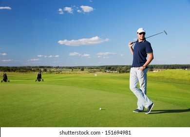portrait of a young male golf player