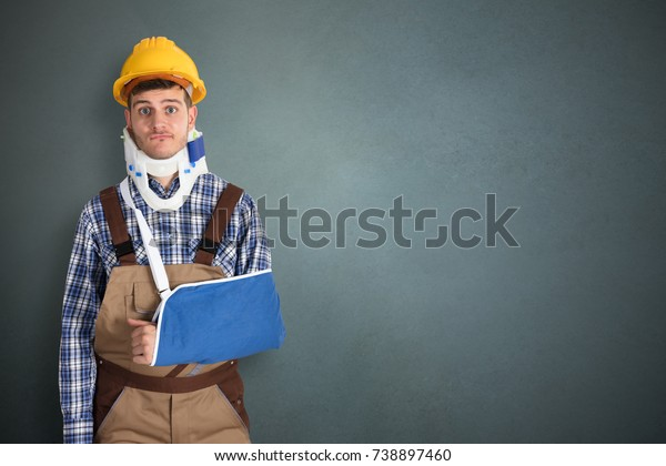 Portrait Of Young Male Handyman With Fractured Hand