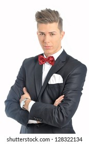 Portrait of young male model with red bow tie and elegant black suit