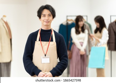 portrait of young male salesperson at the boutique