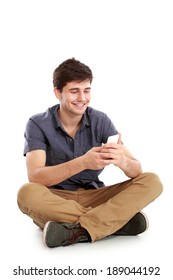portrait of young male smiling using mobile phone on white background