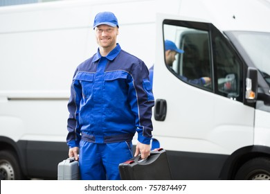 Portrait Of A Young Male Worker In Blue Uniform