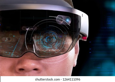 Portrait of young man with 3D virtual reality eye wear glasses hololens | Eye focus magic matrix
