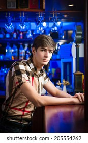 portrait of a young man at the bar, spending time in a nightclub