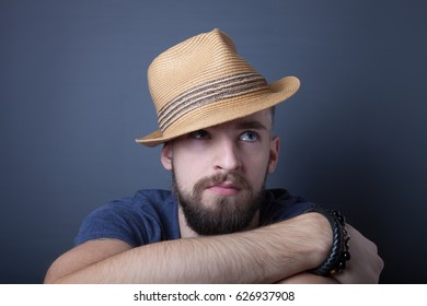 Portrait of a young man with a beard.