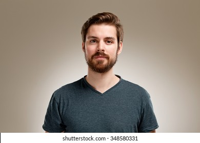 Portrait of young man with beard, on neutral background