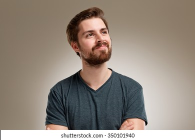 Portrait of young man with beard, think about somethink nice