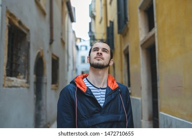 portrait of young man between buildings in Italy