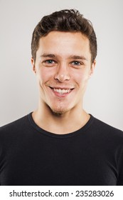 Portrait of young man with black shirt in studio setting