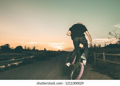 Portrait of a young man with a bmx bicycle. BMX rider