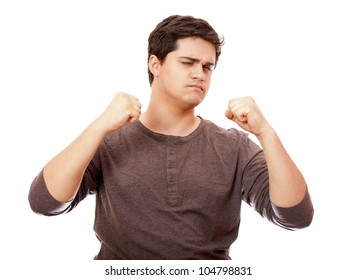 Portrait of young man with clenched fist. Isolated on white background