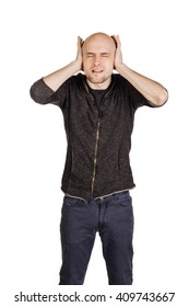 Portrait of a young man closing ears with hands. human emotion expression and lifestyle concept. image on a white studio background.
