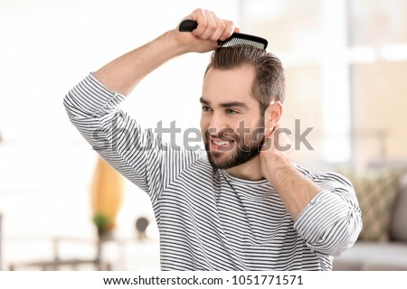 Portrait Young Man Combing His Hair Stock Photo Edit Now