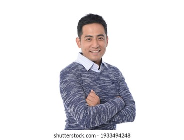 portrait of young man with crosses arms standing on white background