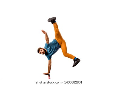Portrait of a young man dancing of joy. Isolated image on white background