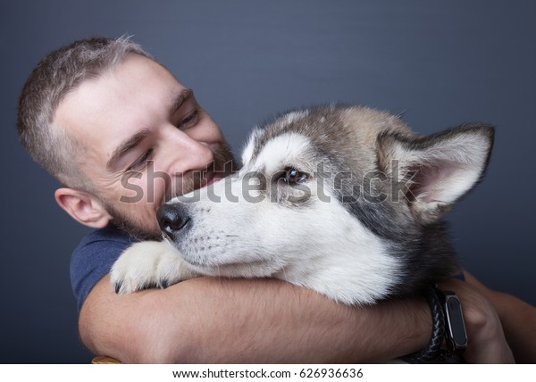 Portrait of a young man with a dog.