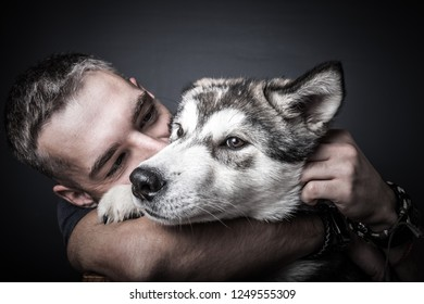 Portrait of a young man with a dog. Toned.