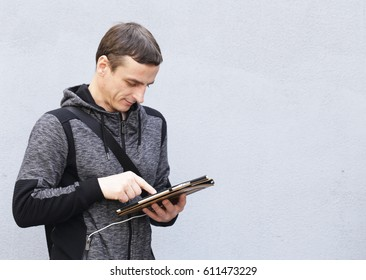 Portrait of a young man with an electronic tablet