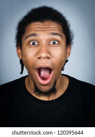 Portrait of young man with emotional facial expression - shocked man