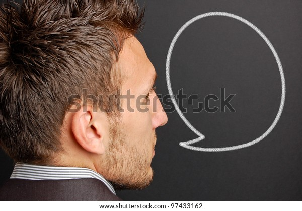 portrait of a young man with a empty speech bubble over his head