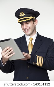 Portrait of a young man in the form of a passenger plane pilot