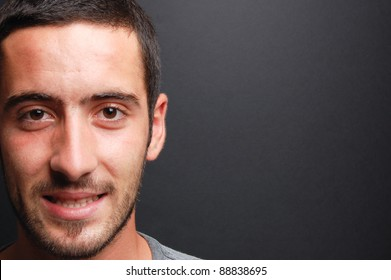 portrait of a young man in front of a chalkboard