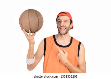 Portrait of young man with a funny expression and basketball ball. Sport concept.