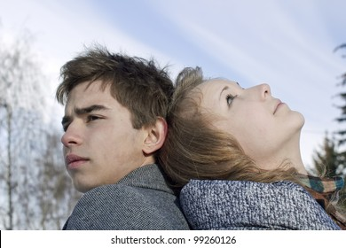 Portrait of the young man and the girl looking every which way