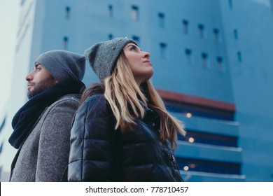 portrait of a young man and a girl in stylish warm clothes. Cold weather