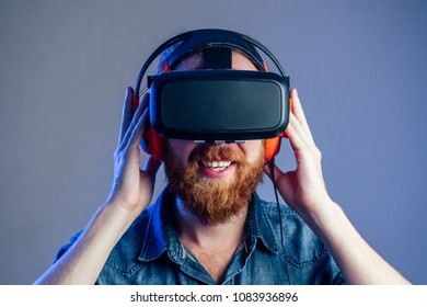portrait of a young man in glasses of virtual reality. The conce